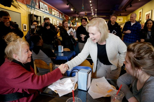 Senator Kirsten Gillibrand, D-N.Y., center, campaigns at the Pierce Street Coffee Works cafe', in Sioux City, Iowa, Friday, Jan. 18, 2019. Sen. Gillibrand is on a weekend visit to Iowa, after announcing that she is forming an exploratory committee to run for President of the United States in 2020. (AP Photo/Nati Harnik)