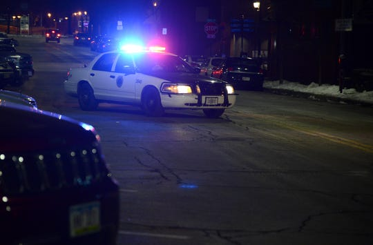 A Des Moines police squad car blocks East Fifth Street on Friday, Jan. 18, 2019, as officers investigate a shooting in the nearby 400 block of East Grand Ave in the city's Historic East Village neighborhood.
