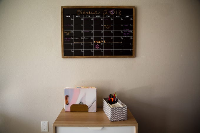 Dates on a calendar hanging in Gina Battani's kitchen are marked for the trial of her ex-husband Troy Griffin, who she accused of rape. A jury found Griffin not guilty of all charges.