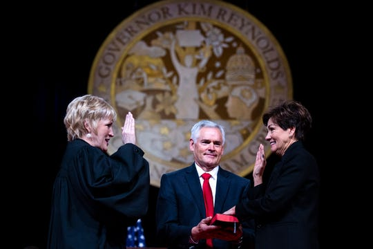 Gov. Kim Reynolds is sworn in as Iowa's first elected female governor by Justice Susan Christensen during the Governor's Inaugural Ceremony on Friday, Jan. 18, 2019, in Des Moines.