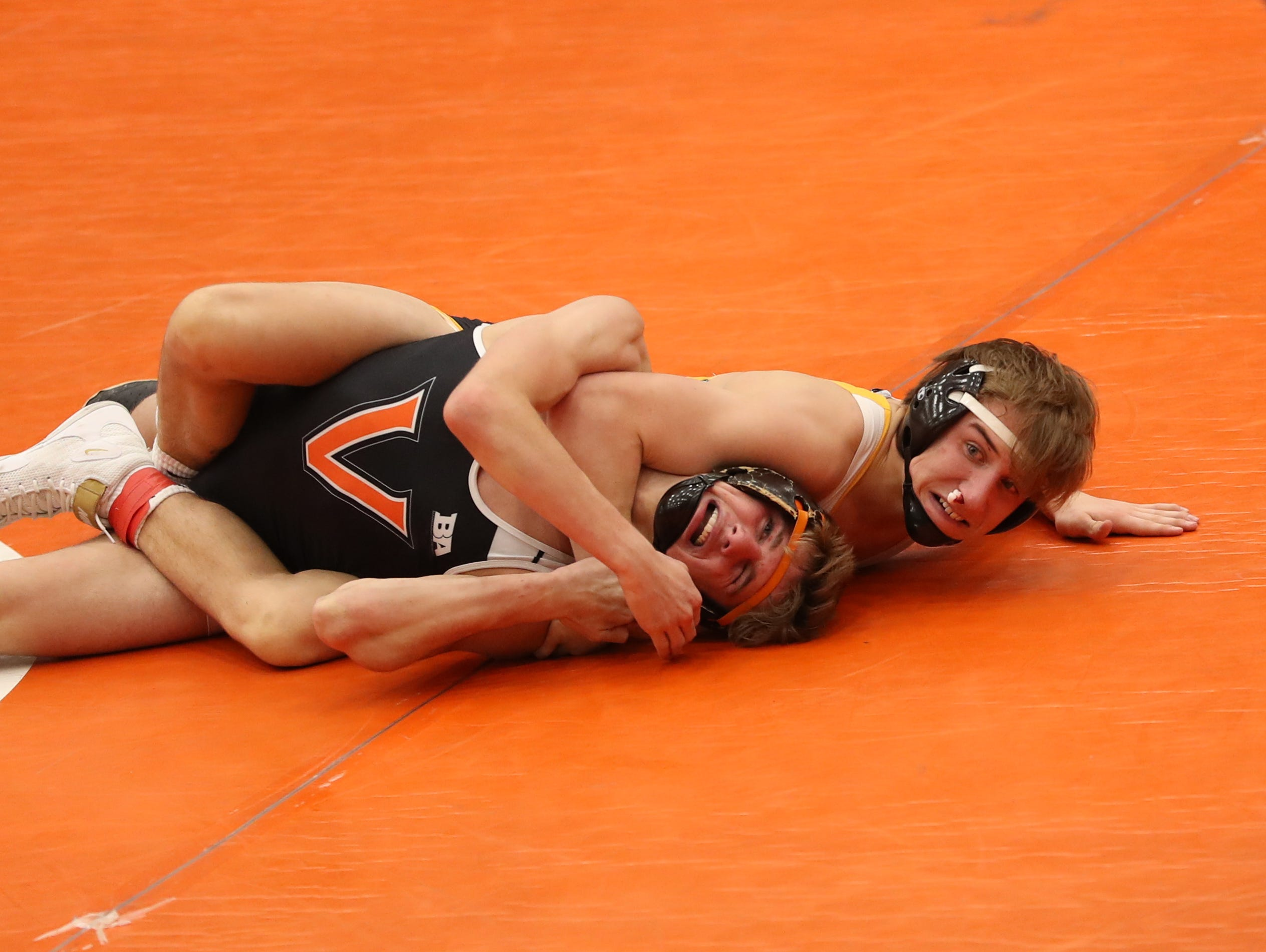 Southeast Polk's Carson Martinson pins Valley's Noah Micka at Valley High School in West Des Moines on Jan. 17, 2019. The Rams beat the Tigers 53 to 20.