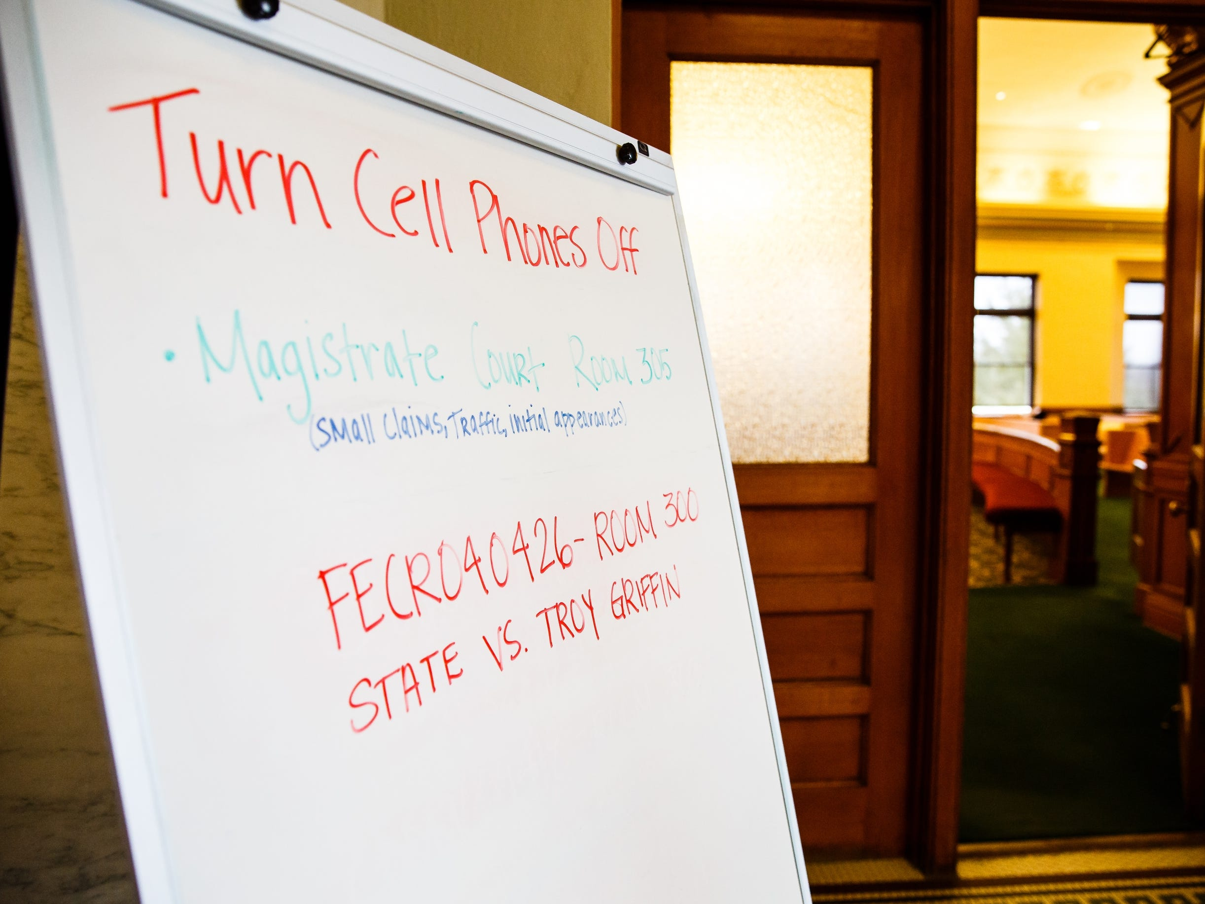 A whiteboard outside of room 300 in the Dallas County courthouse instructs visitors of the case and to turn off their phones on Thursday, Oct. 25, 2018, in Adel.