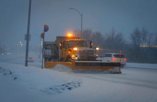 A West Des Moines snow plow clears a path along Western Parkway during heavy snowfall on Friday, Jan. 18, 2019.