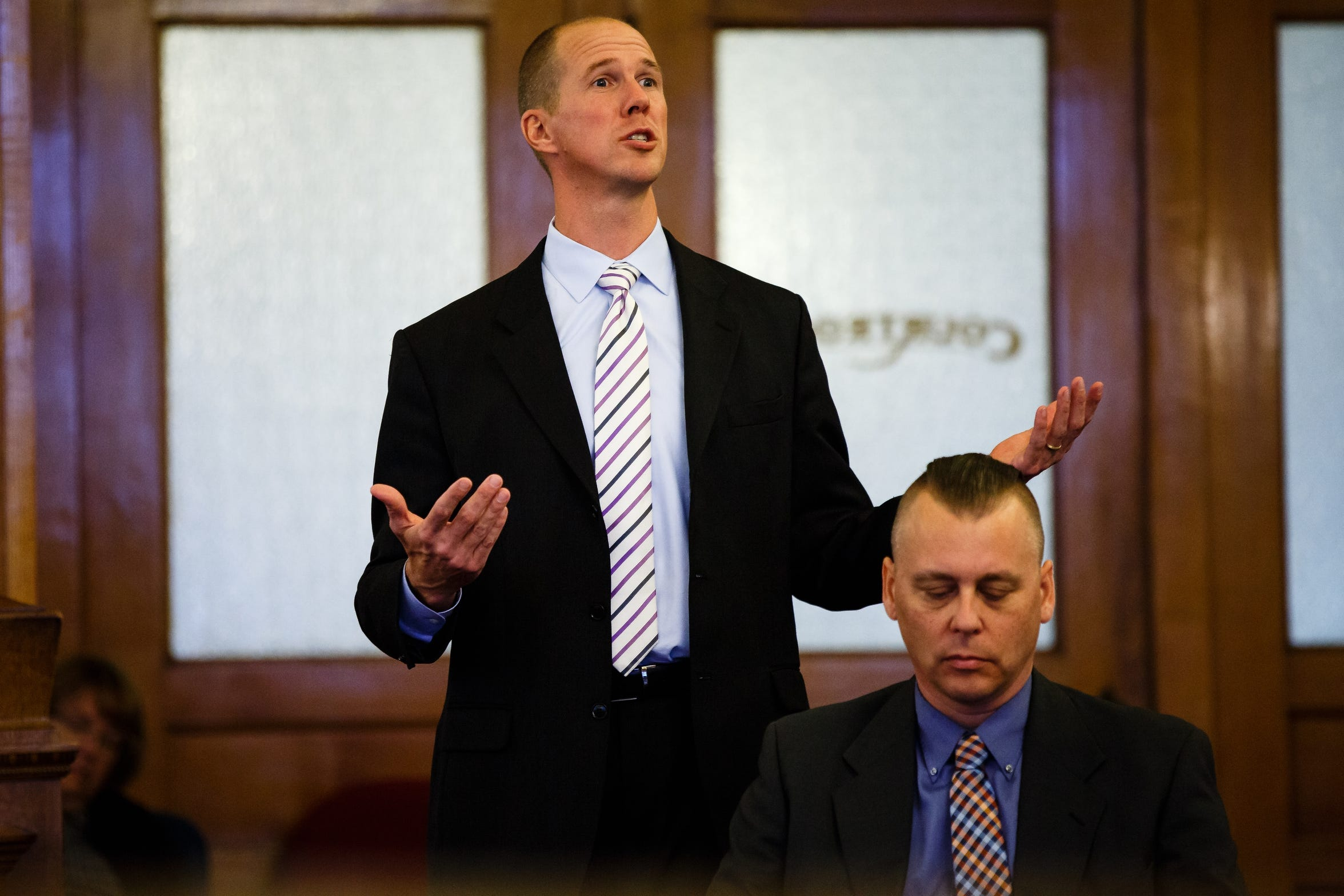 Troy Griffin, seated, listens as his defense lawyer, Robert Rehkemper, makes his opening statement at the Dallas County Courthouse on Monday, Oct. 22, 2018, in Adel. Griffin's ex-wife Gina Battani accused him of raping her repeatedly while they were married. A jury found Griffin not guilty.