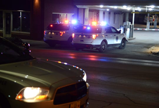 Des Moines police vehicles can be seen Friday, Jan. 18, 2019, on East Sixth Street as officers investigate a shooting in the nearby 400 block of East Grand Ave in the city's Historic East Village neighborhood.