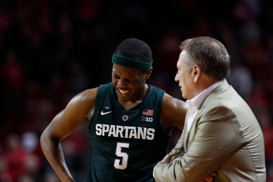 Michigan State Spartans guard Cassius Winston (5) laughs while talking with head coach Tom Izzo during the game against the Nebraska Cornhuskers in the second half at Pinnacle Bank Arena. Michigan State won 70-64 on Thursday, Jan. 17, 2019.