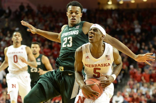 Glynn Watson Jr. #5 of the Nebraska Cornhuskers drives past Xavier Tillman #23 of the Michigan State Spartans at Pinnacle Bank Arena on January 17, 2019 in Lincoln, Nebraska.
