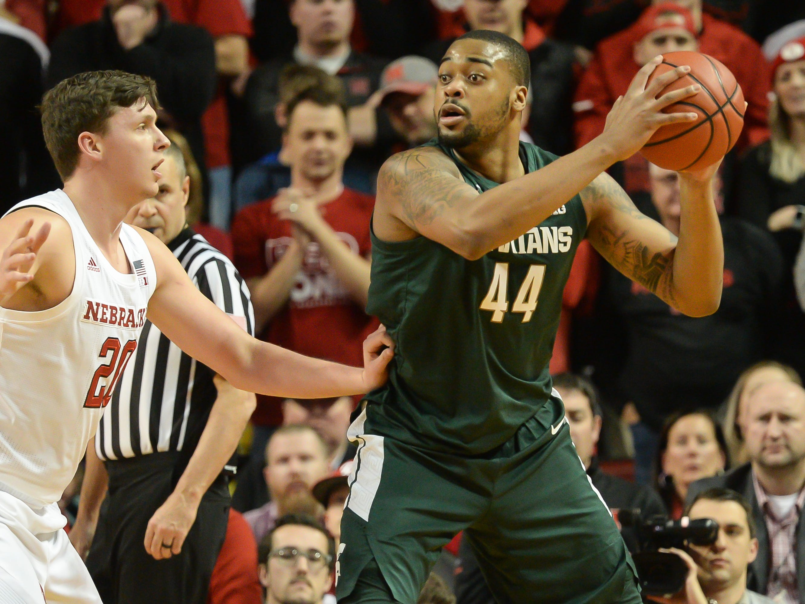 Nick Ward #44 of the Michigan State Spartans drives on Tanner Borchardt #20 of the Nebraska Cornhuskers at Pinnacle Bank Arena on January 17, 2019 in Lincoln, Nebraska.