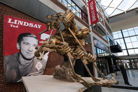 A statue of former Detroit Red Wings player Ted Lindsay is seen on display in the concourse of  the Little Caesars Arena in downtown Detroit in September 2017.