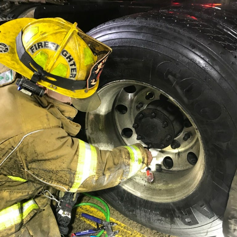 Firefighters rescue man trapped between semi tires in Plymouth Twp.