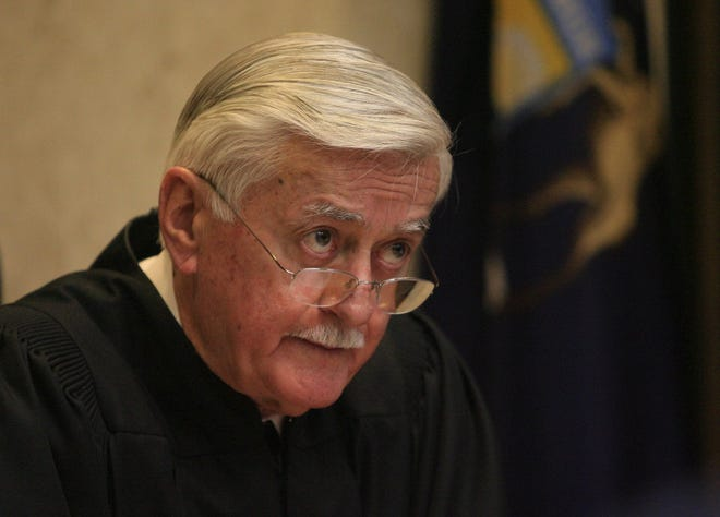 Judge Donald Miller in a Macomb circuit courtroom on April 13, 2010.