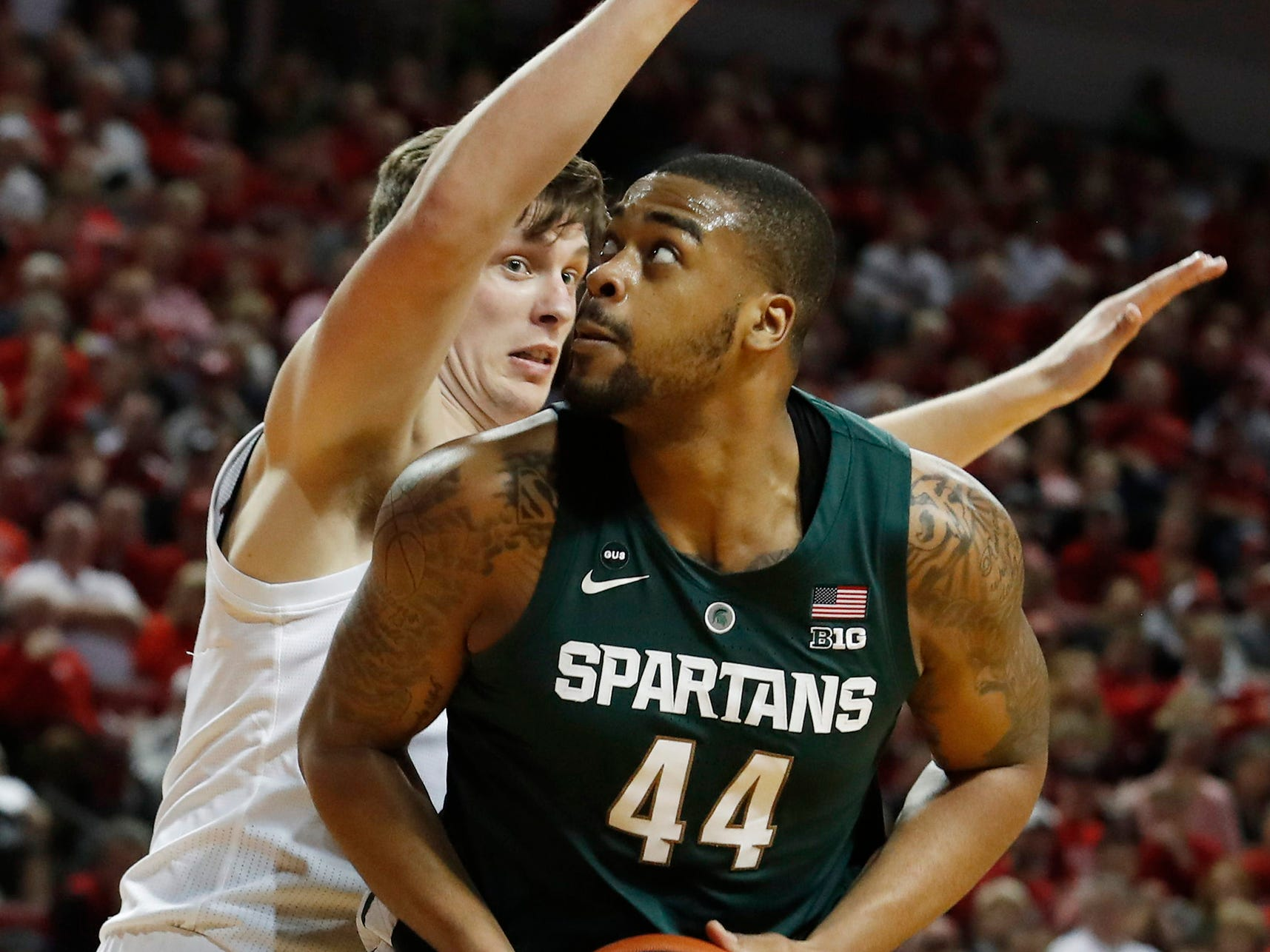 Michigan State Spartans forward Nick Ward (44) controls the ball in front of Nebraska Cornhuskers forward Tanner Borchardt (20) in the second half at Pinnacle Bank Arena. Michigan State won 70-64 on Thursday, Jan. 17, 2019.
