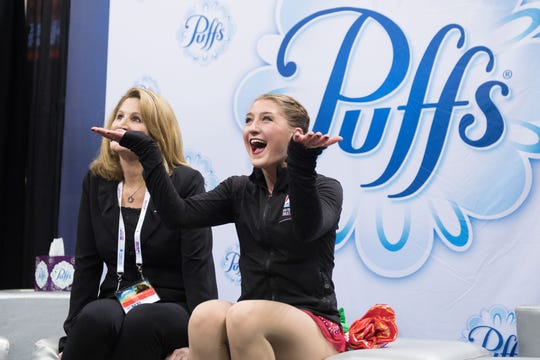 Hannah Miller smiles with coach Kirsten Miller-Zisholz in the kiss and cry after skating in the ladies short program during the 2018 U.S. Figure Skating Championships in San Jose, California.