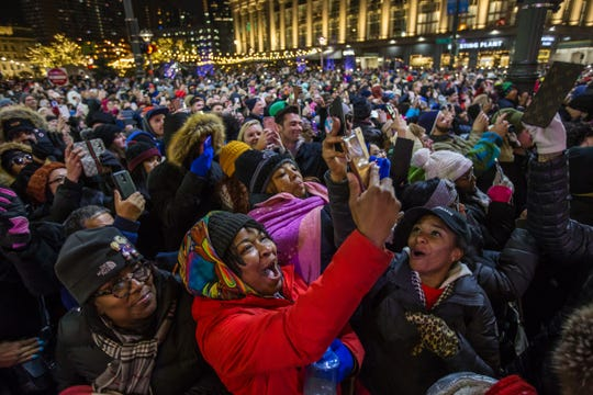 Delon Jordan (center) of Oak Park cheers with others in the crowd as the tree is lit during the annual tree lighting event at Campus Martius Park in downtown Detroit on Friday, November 16, 2018.