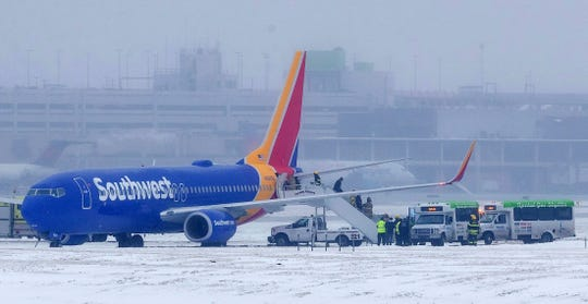 Passengers exit Southwest Airlines flight 1643 after the plane slid off the runway at Eppley Airfield Friday, Jan 18, 2019, in Omaha, Neb.