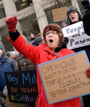 """Marshia Cordray, 66, of Ypsilanti, an FDA employee, chants """"call a vote"""" along with other furloughed workers during a rally at the McNamara Federal Building in downtown Detroit on Friday."""