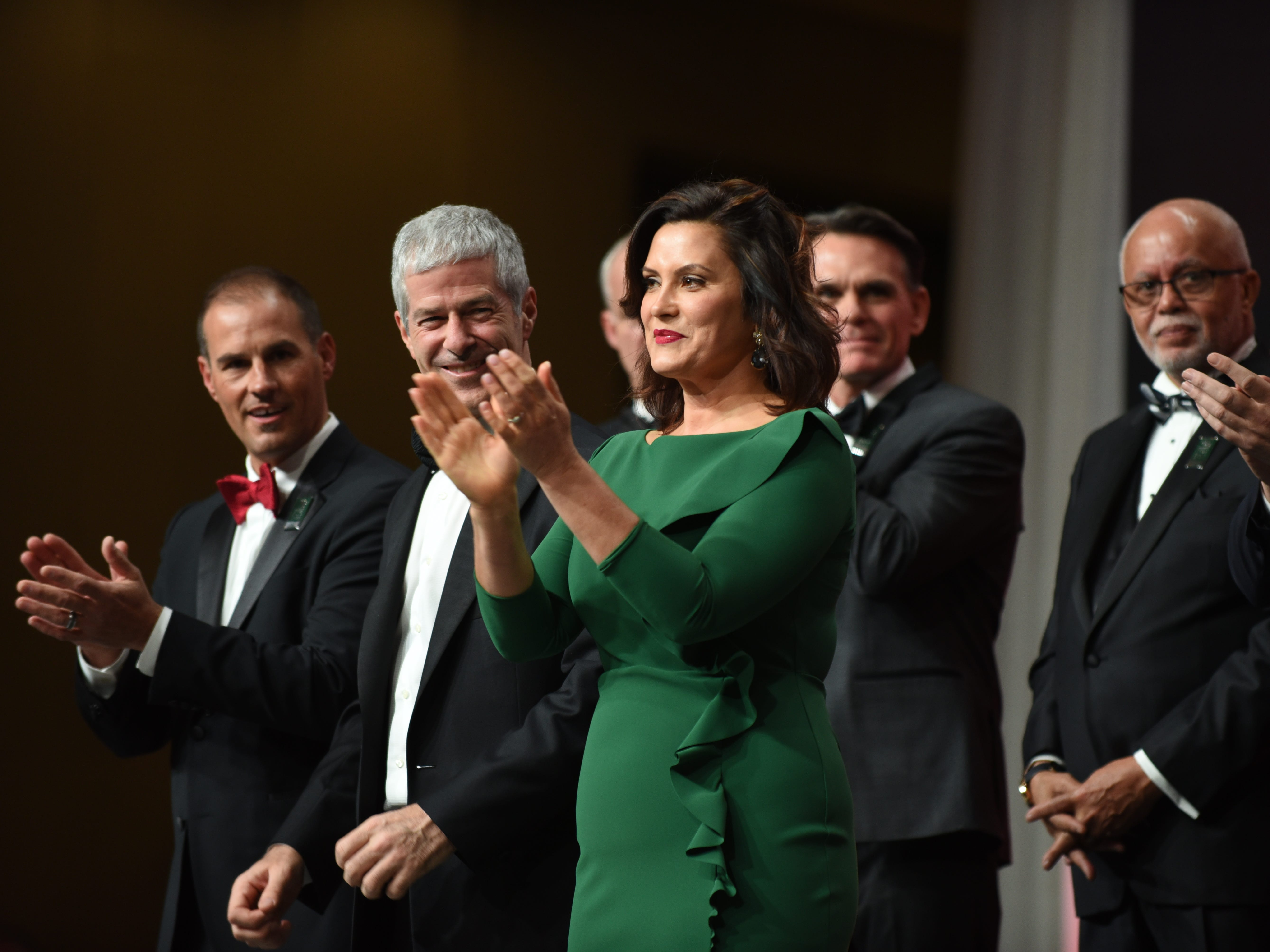 Michigan Gov. Gretchen Whitmer claps during the introductions.