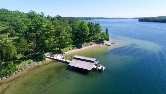 This $6.99M estate on Lake Charlevoix sits along 3,000 feet of sandy lake front.