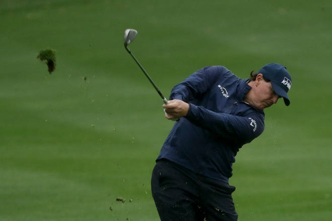 Phil Mickelson hits from the fairway on the fifth hole.