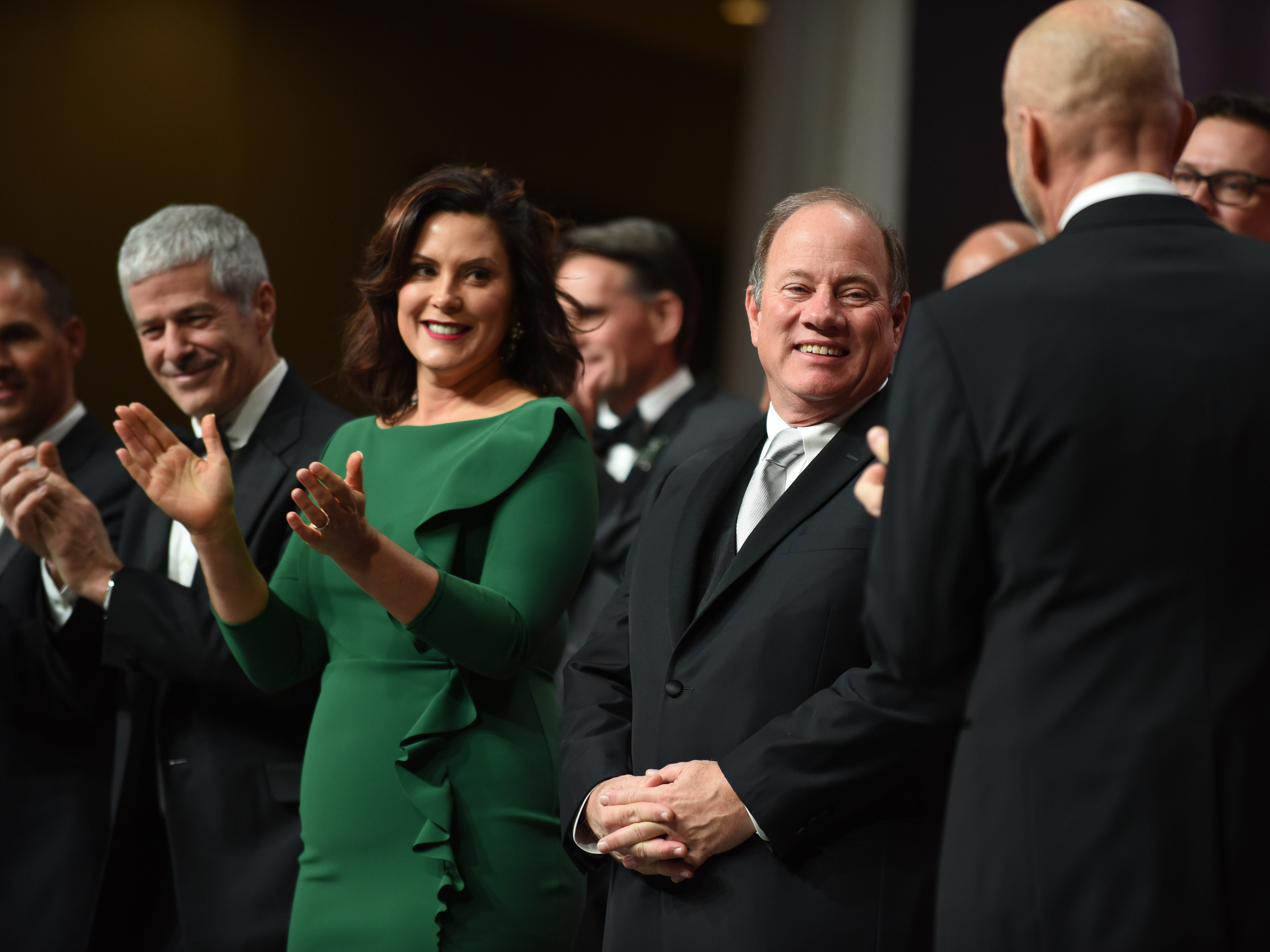 Michigan Gov. Gretchen Whitmer and Detroit Mayor Mike Duggan smile during the ribbon-cutting.