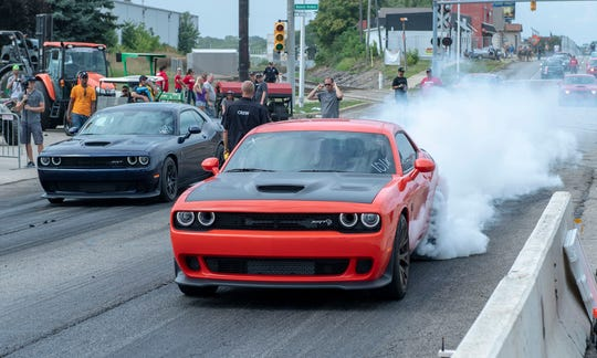 Two Dodge Challenger SRT Hellcats face off at the fourth annual Roadkill Nights Powered by Dodge event