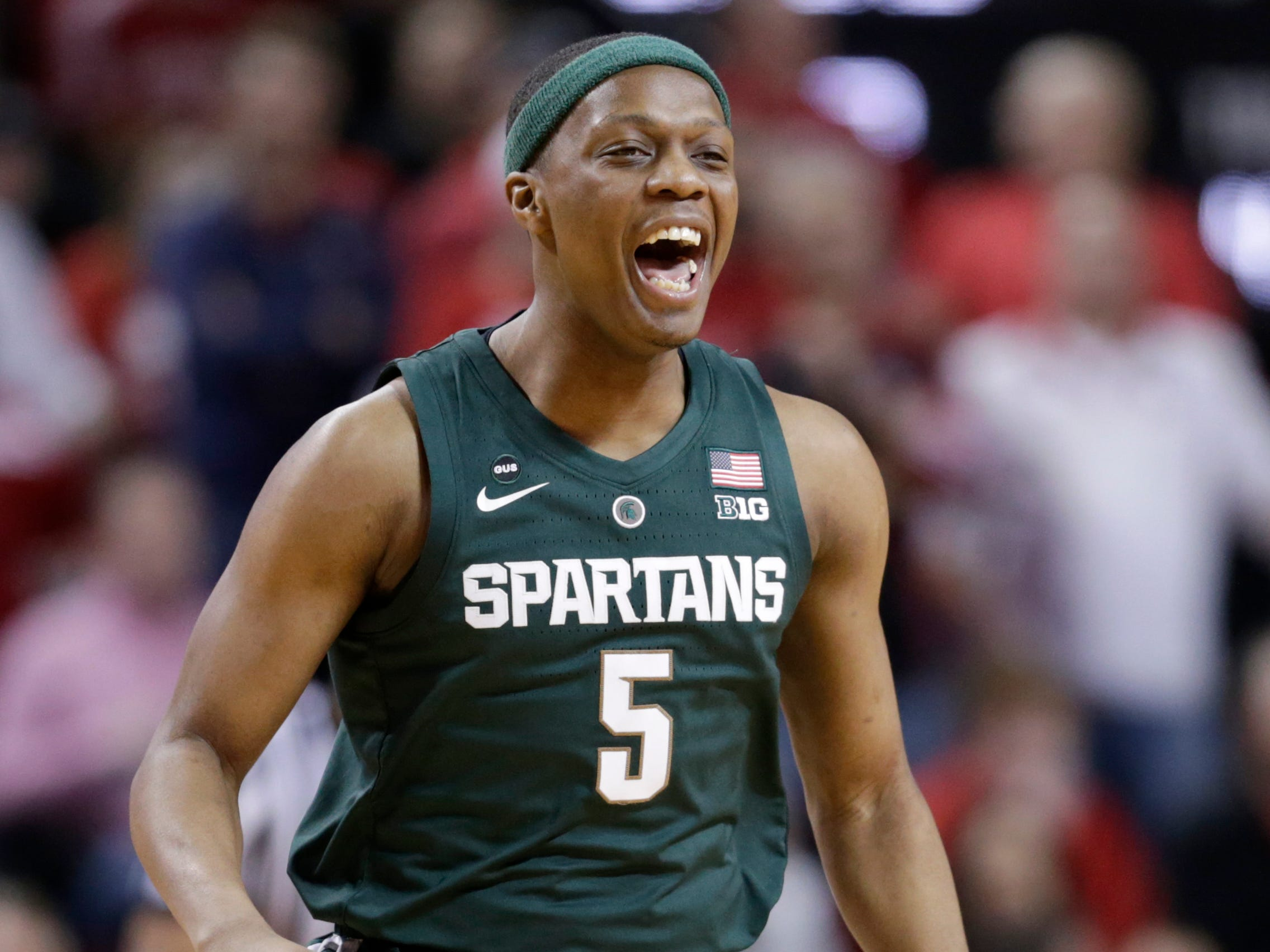 Michigan State's Cassius Winston (5) reacts after scoring a 3-point shot during the first half.