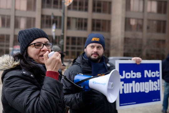 U.S. Rep. Rashida Tlaib (D-Detroit) speaks into a bullhorn during a rally of furloughed workers at the Patrick V McNamara Federal Building in downtown Detroit on Friday, January 18, 2019.  The protestors demanded an end to the partial government shutdown.