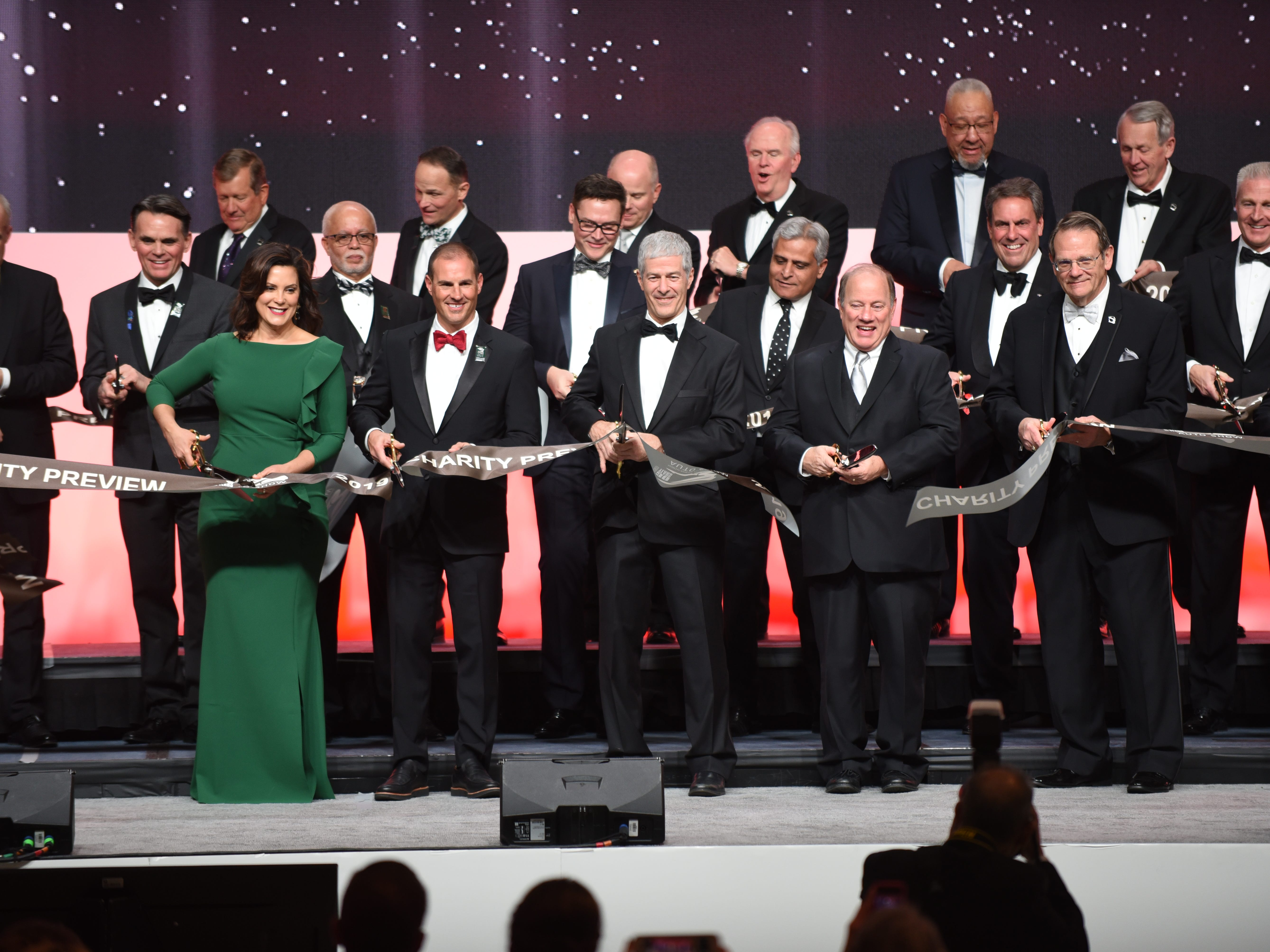 Michigan Gov. Gretchen Whitmer,  Detroit Mayor Mike Duggan and auto executives cut the ribbon on the 2019 Auto Show Charity Preview on Jan. 18, 2018.