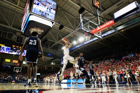 Killian Tillie of the Gonzaga Bulldogs goes to the basket against the Loyola Marymount Lions.