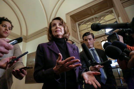 Speaker of the House Nancy Pelosi, D-Calif., takes questions from reporters, Friday, Jan. 18, 2019, on Capitol Hill in Washington.