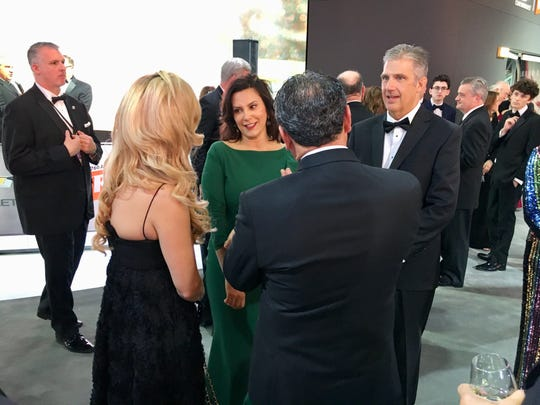 Gov. Gretchen Whitmer and her husband, Marc Mallory, greet partygoers at the Chevy section of the NAIAS Charity Preview.