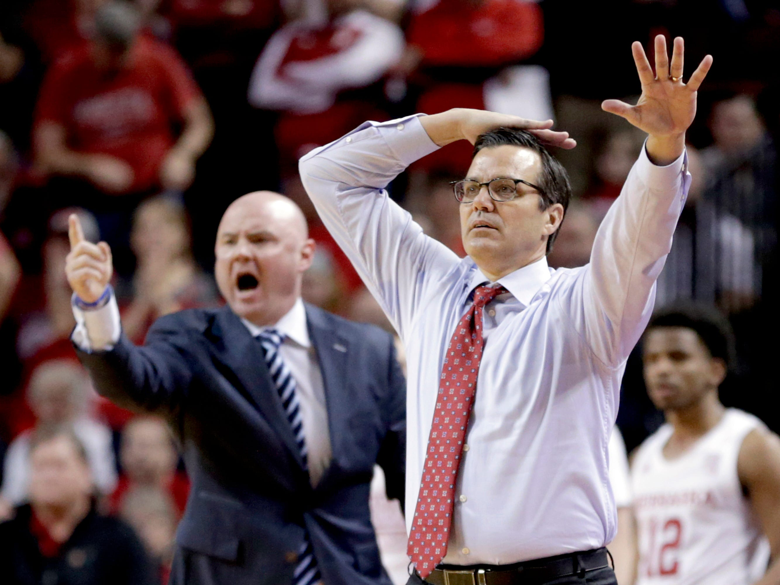 Nebraska coach Tim Miles signals a play during the first half.