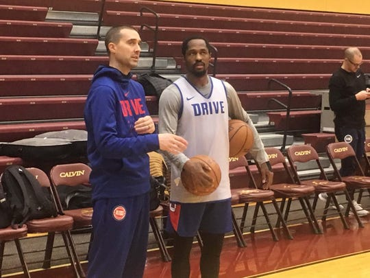 Former Michigan State star Kalin Lucas, right, talks with Grand Rapids Drive coach Ryan Krueger after practice Thursday at Calvin College in Grand Rapids.