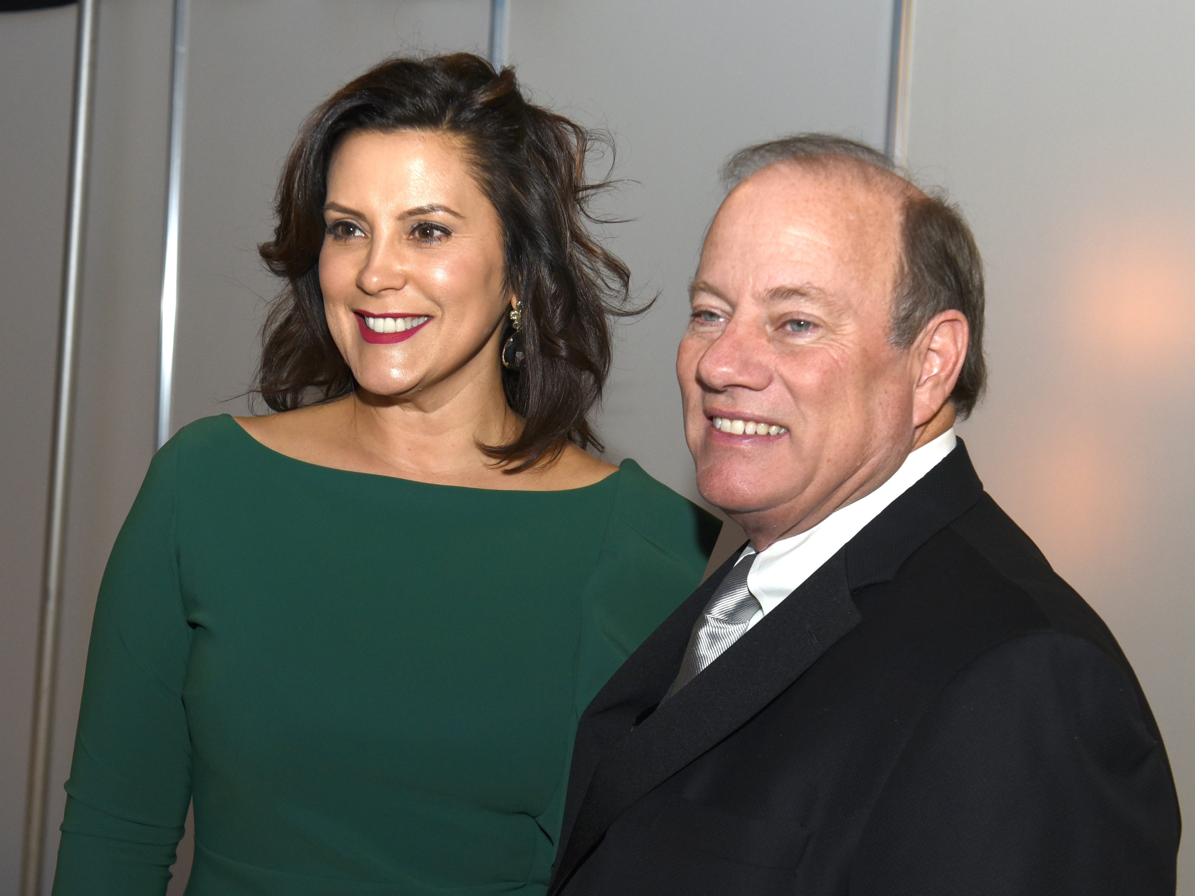 Michigan Gov. Gretchen Whitmer with Detroit Mayor Mike Duggan at the 2019 Auto Show Charity Preview.