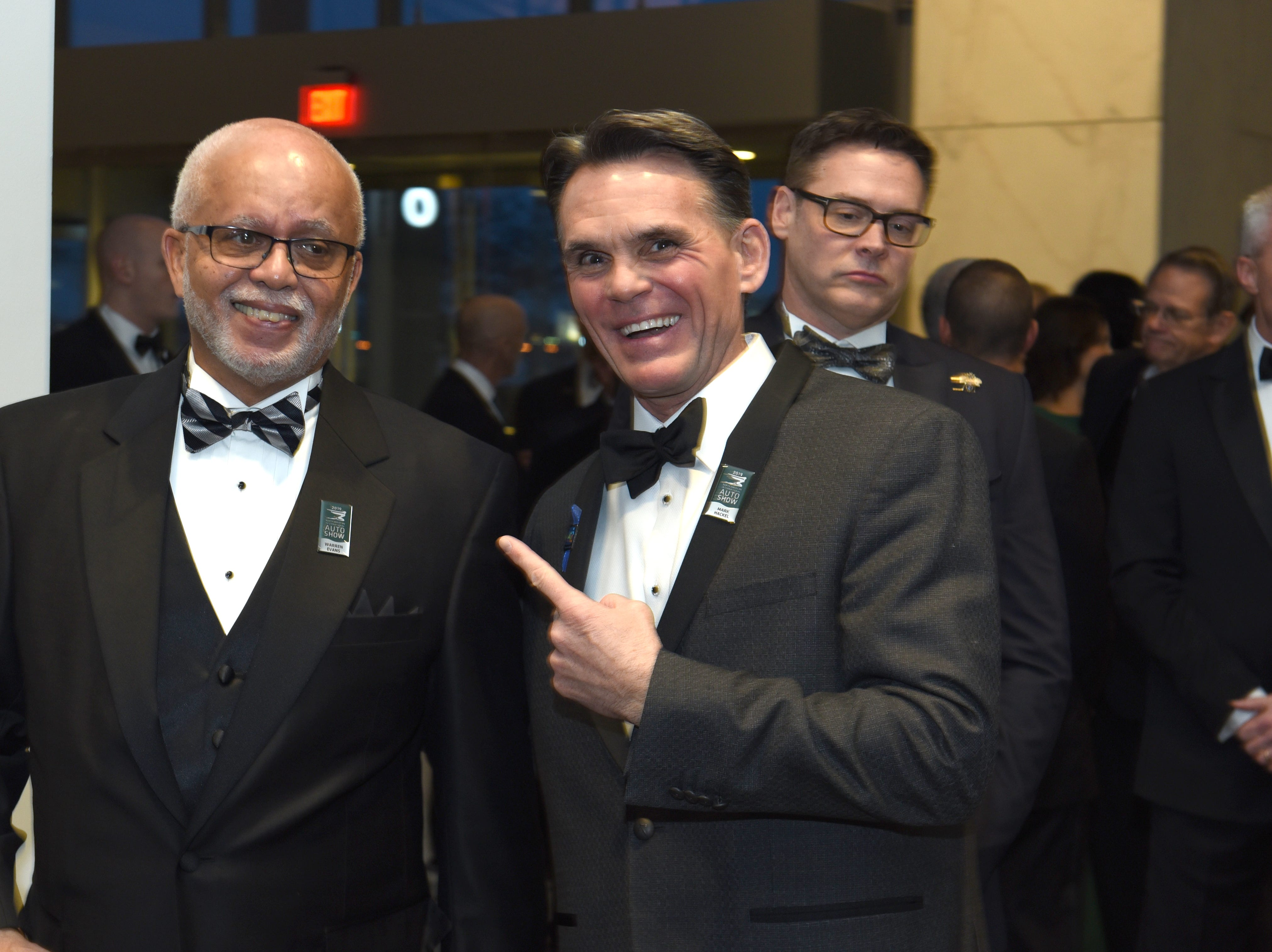 Wayne County Executive Warren Evans, left, and Macomb County Executive  Mark Hackel share a moment at the 2019 Charity Preview.