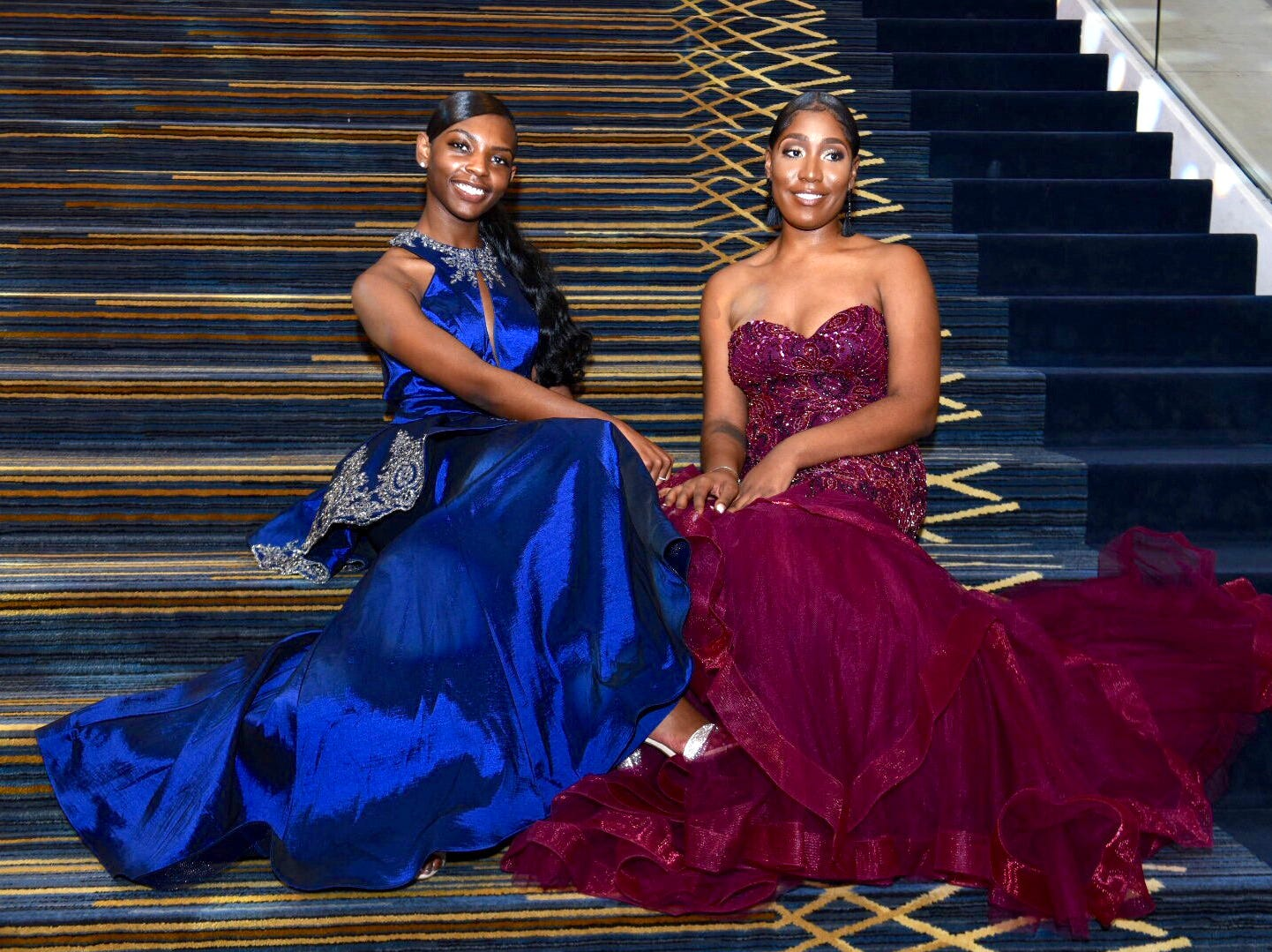 Kamari Ray, left, and Audrey Johnson, both of Detroit, pose in the Atrium at Cobo Center after arriving at the 2019 Auto Show Charity Preview gala Friday, Jan. 18.