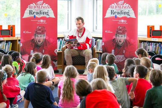 Justin Abdelkader reads to young students as part of his Abby's All-Stars program.