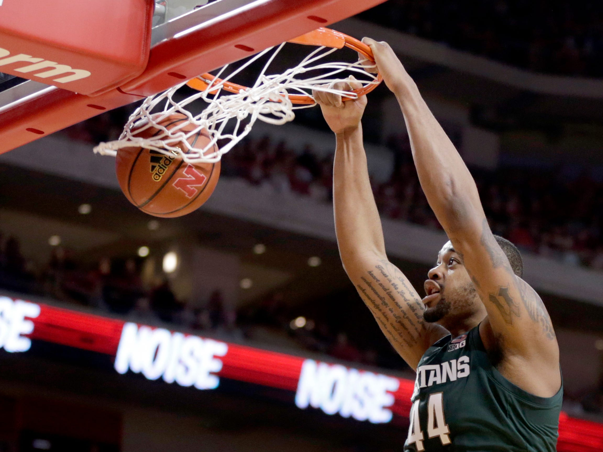 Michigan State's Nick Ward (44) dunks as Nebraska's Isaiah Roby (15) watches during the second half.