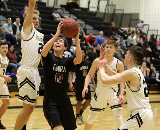 Nolan Collins of Elmira looks for his shot as Corning's Lucas Rossington (left), Jordan Haggard (center) and Aiden Chamberlin defend Jan. 17, 2019 at Corning-Painted Post High School.