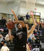 Daron Driscoll of Elmira goes up for a layup as Corning's Nick Garner defends Jan. 17, 2019 at Corning-Painted Post High School.