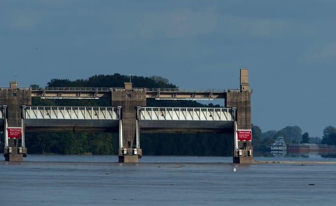 The gates are open at the Newburgh Dam on the Ohio River as waters continued to rise Monday morning, Sept. 10, 2018. Previous attempts to develop hydroelectric power generation at the Newburgh Lock and Dam have quietly died because of a long, costly permitting process. A bill authored by 8th District Representative Larry Buschon and passed by Congress in September aims to dramatically shorten the process.
