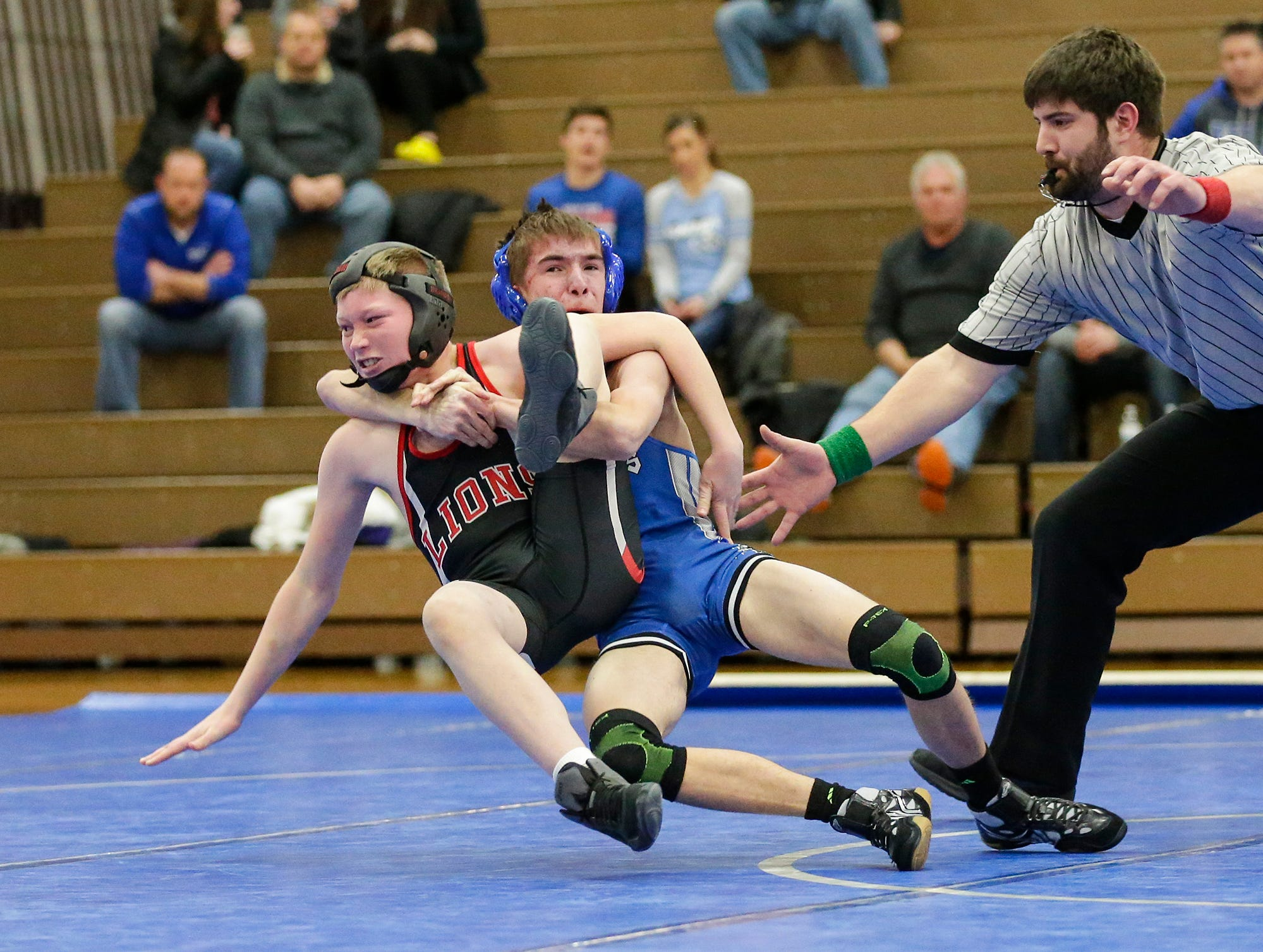 Winnebago Lutheran Academy's Jacob Blitiz wrestles Brandon Faber of Lomira High School in the 113 pound weight class Thursday, January 17, 2019 in Fond du Lac. Faber won by a score of 4-3  and Lomira won the meet 51-22. Doug Raflik/USA TODAY NETWORK-Wisconsin