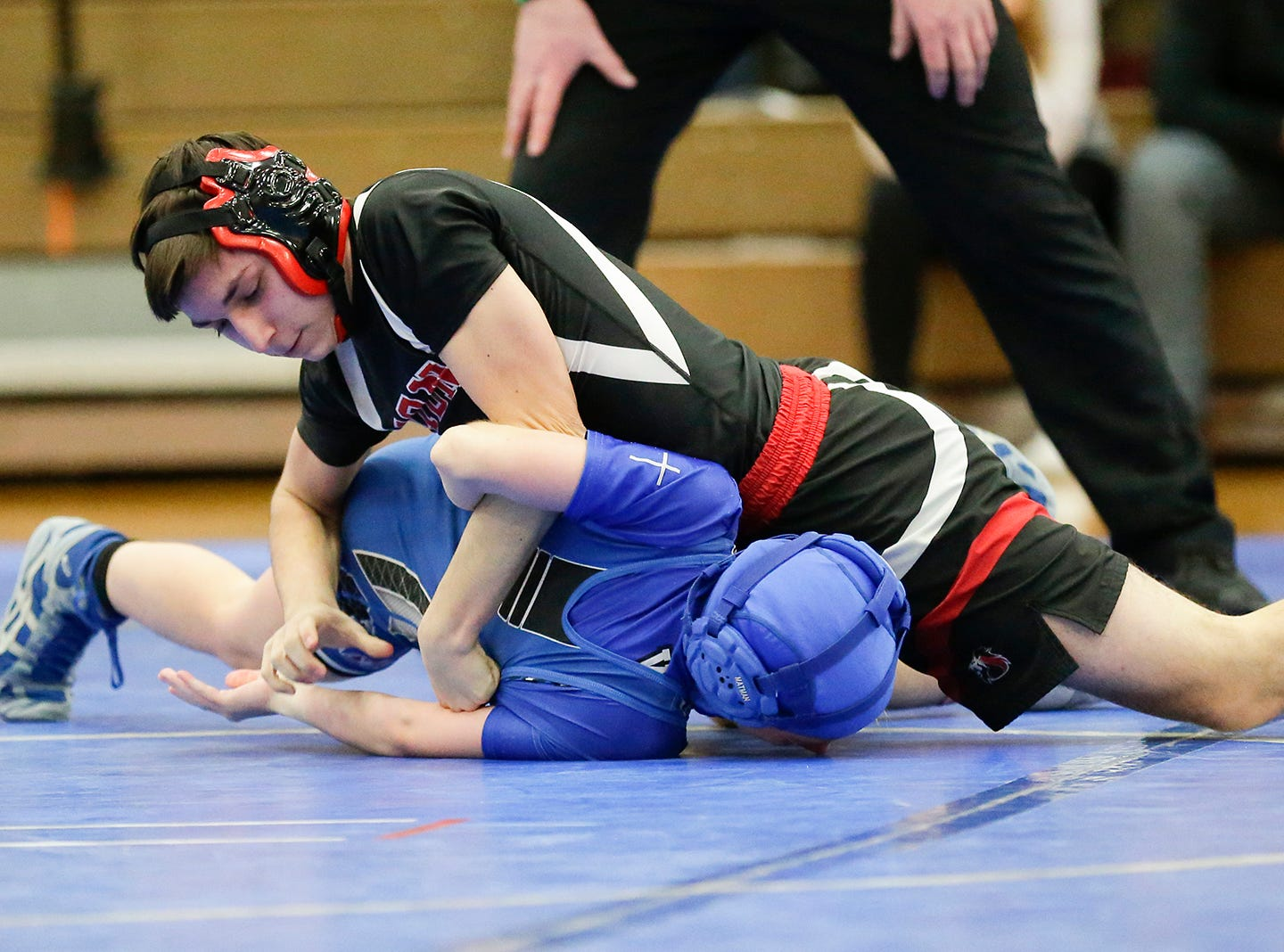 Winnebago Lutheran Academy's Ashleigh Olson wrestles Carlos Lopez of Lomira High School in the 106 pound weight class Thursday, January 17, 2019 in Fond du Lac. Lopez won by a pin and Lomira won the meet 51-22. Doug Raflik/USA TODAY NETWORK-Wisconsin