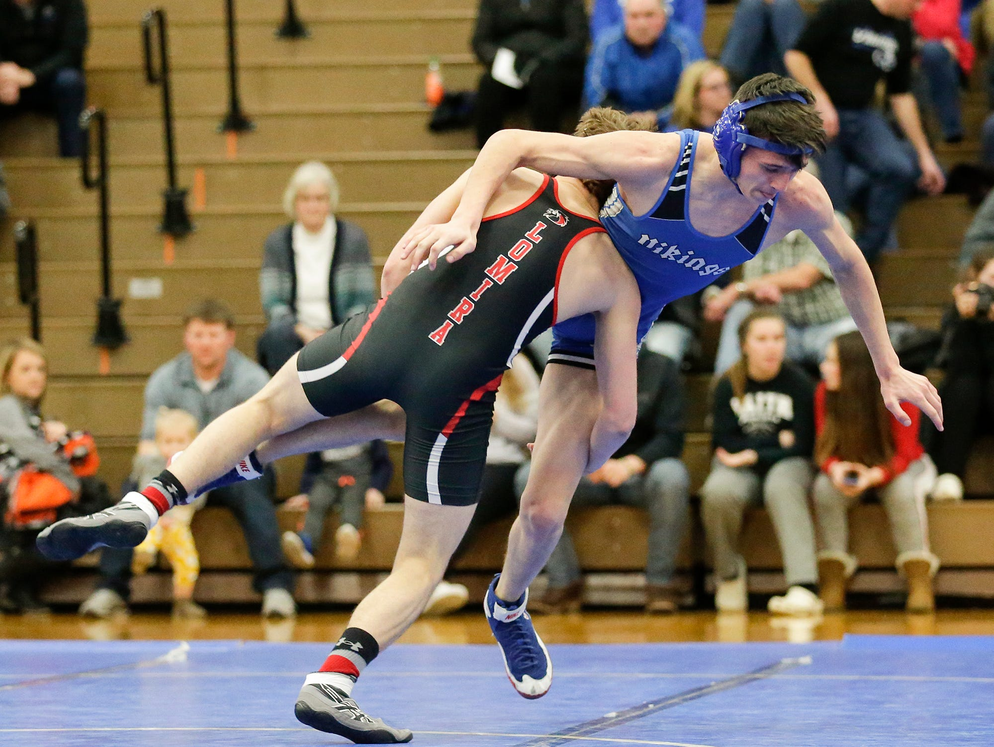 Winnebago Lutheran Academy's Micah Hinds wrestles Adam Sauer of Lomira High School in the 138 pound weight class Thursday, January 17, 2019 in Fond du Lac. Sauer won by a score of 12-5 and Lomira won the meet 51-22. Doug Raflik/USA TODAY NETWORK-Wisconsin