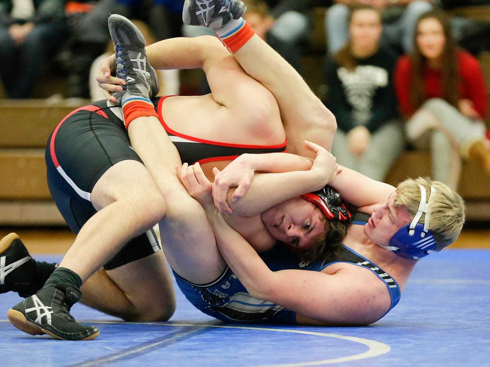 Winnebago Lutheran Academy's Noah Hoppe wrestles Alex Pilling of Lomira High School in the 220 pound weight class Thursday, January 17, 2019 in Fond du Lac. Hoppe won by a pin and Lomira won the meet 51-22. Doug Raflik/USA TODAY NETWORK-Wisconsin