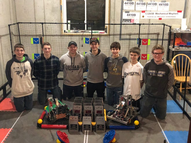 The South Eden Robotics Club with their robots and trophies from this season. From left, Connor Hamm, Ike Grahl, Mitchell Gonzalez, Henry Hathaway, Joe Krahn, Garrett Roehl and Jacob Fabry.