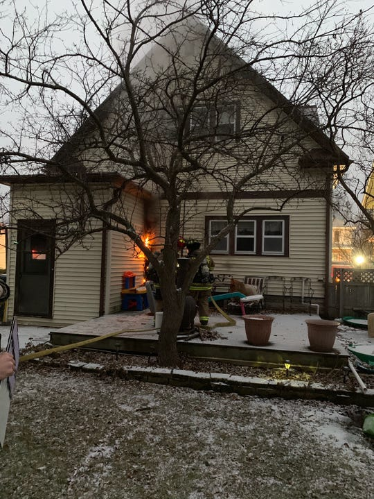 Fire crews put on flames on a home's exterior in the 100 block of Warner Street.