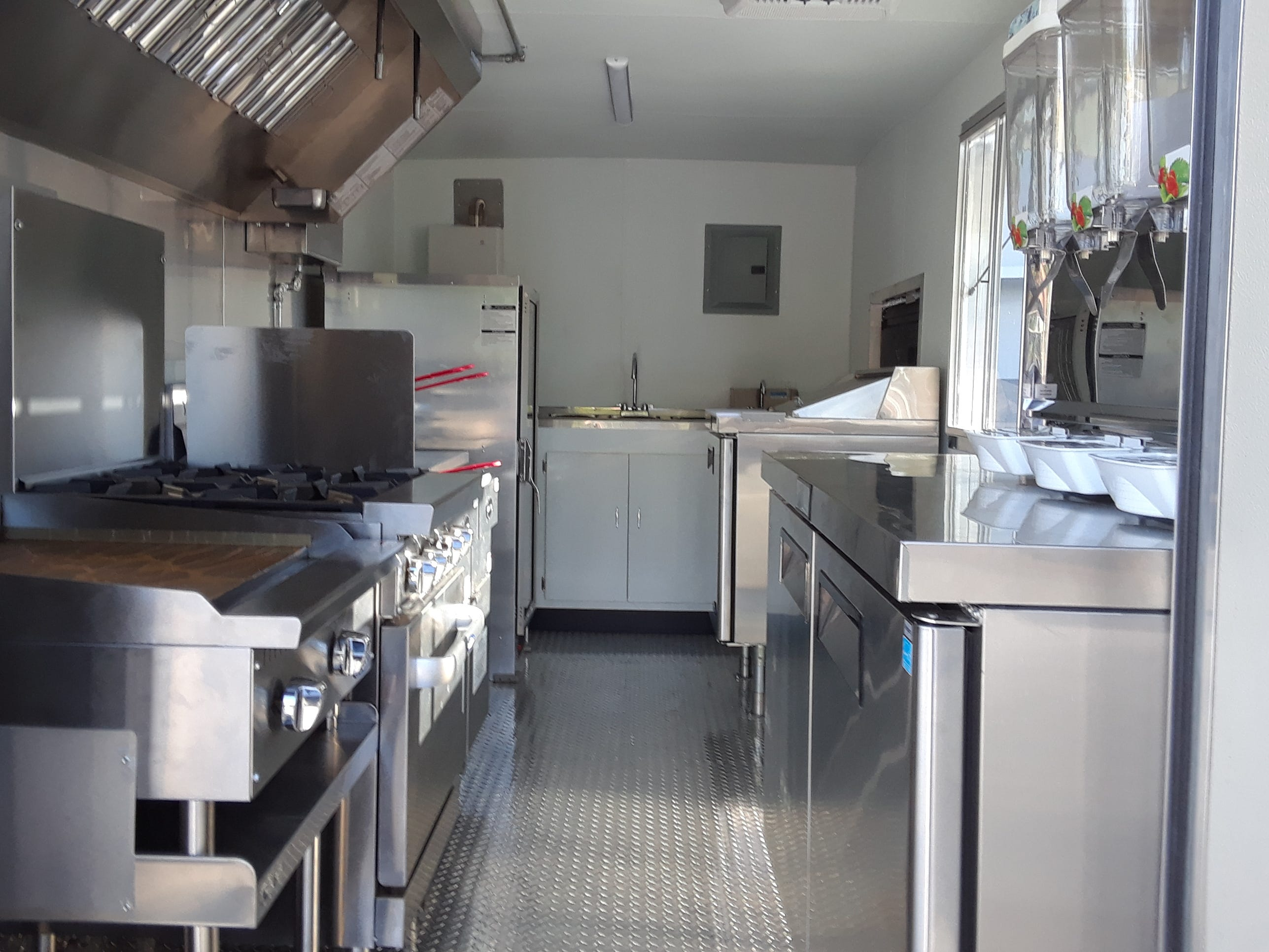 The inside of the Schnitzel Express food truck is spotless and tidy, with all the equipment needed for a full-service restaurant.
