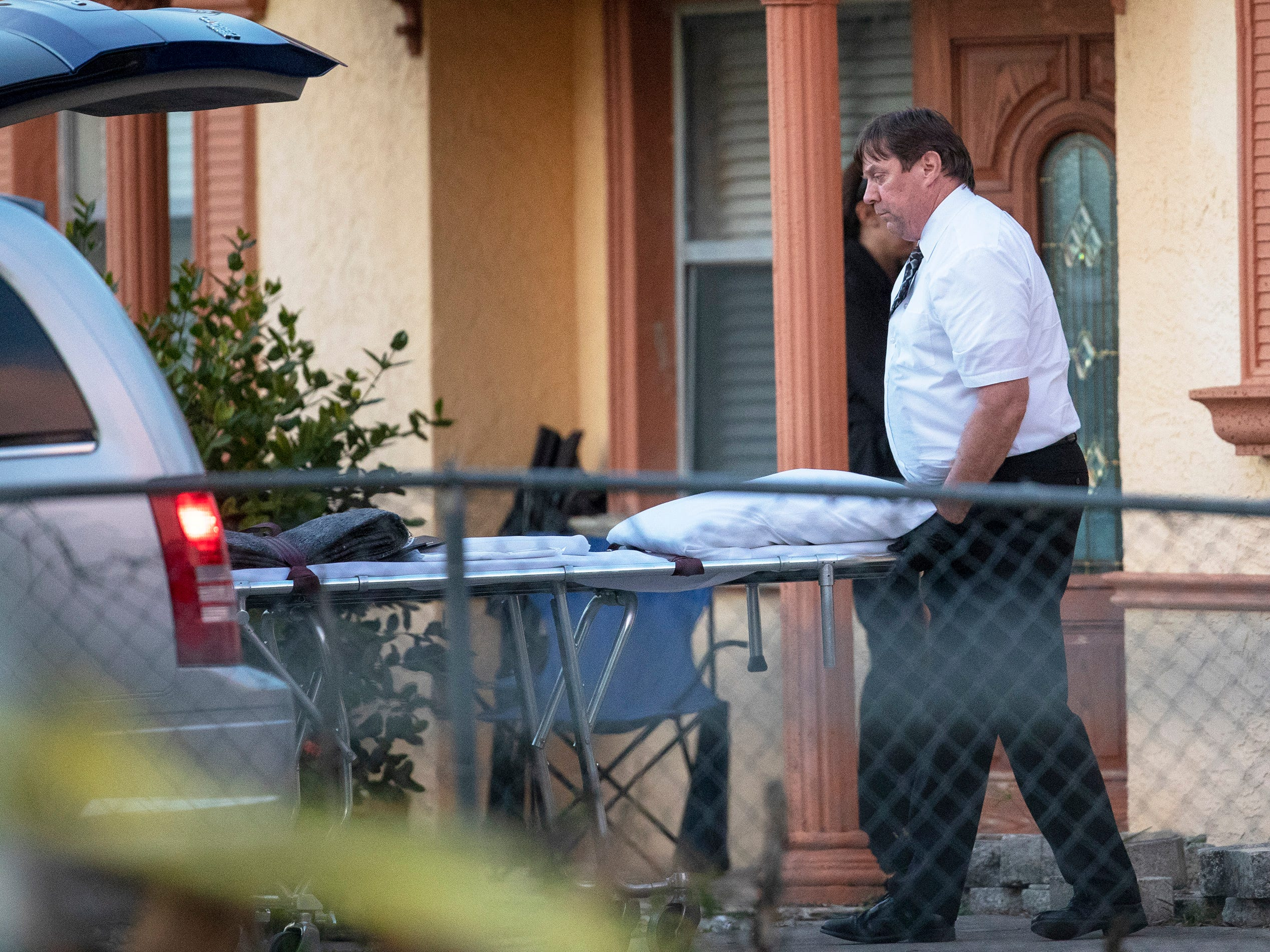The Lee County medical examiner arrives at a Fort Myers home on Thursday where a mother and her 10-year-old son were found dead. The Fort Myers Police Department has not provided the cause of death and are still investigating.