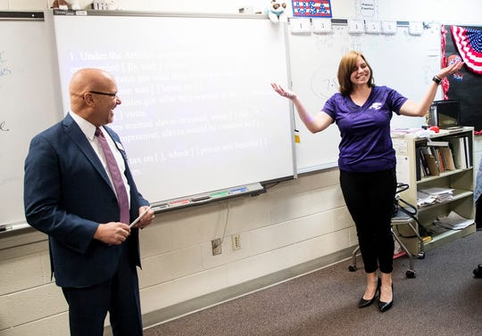Brittany Camp a teacher at Cypress Lake High School Center for the Arts was one of 30 finalists nominated for a Golden Apple on Friday 1/18/2019. Presenting the nomination is Marshall Bower, president and CEO of the Foundation for Lee County Public Schools.